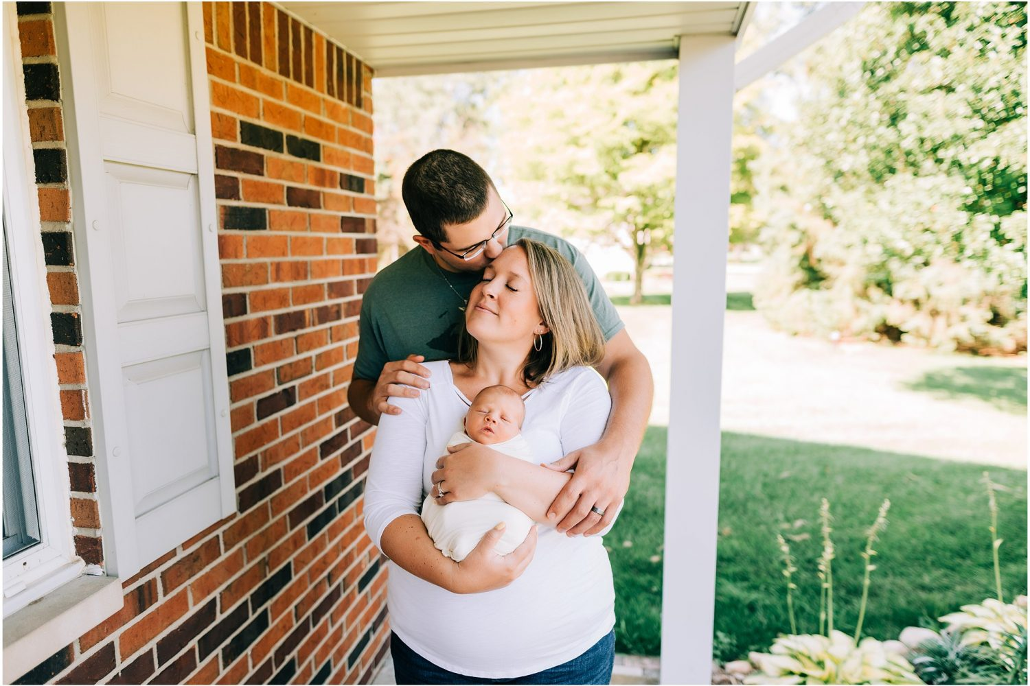 Family lifestyle newborn photo outside on the porch in Brighton