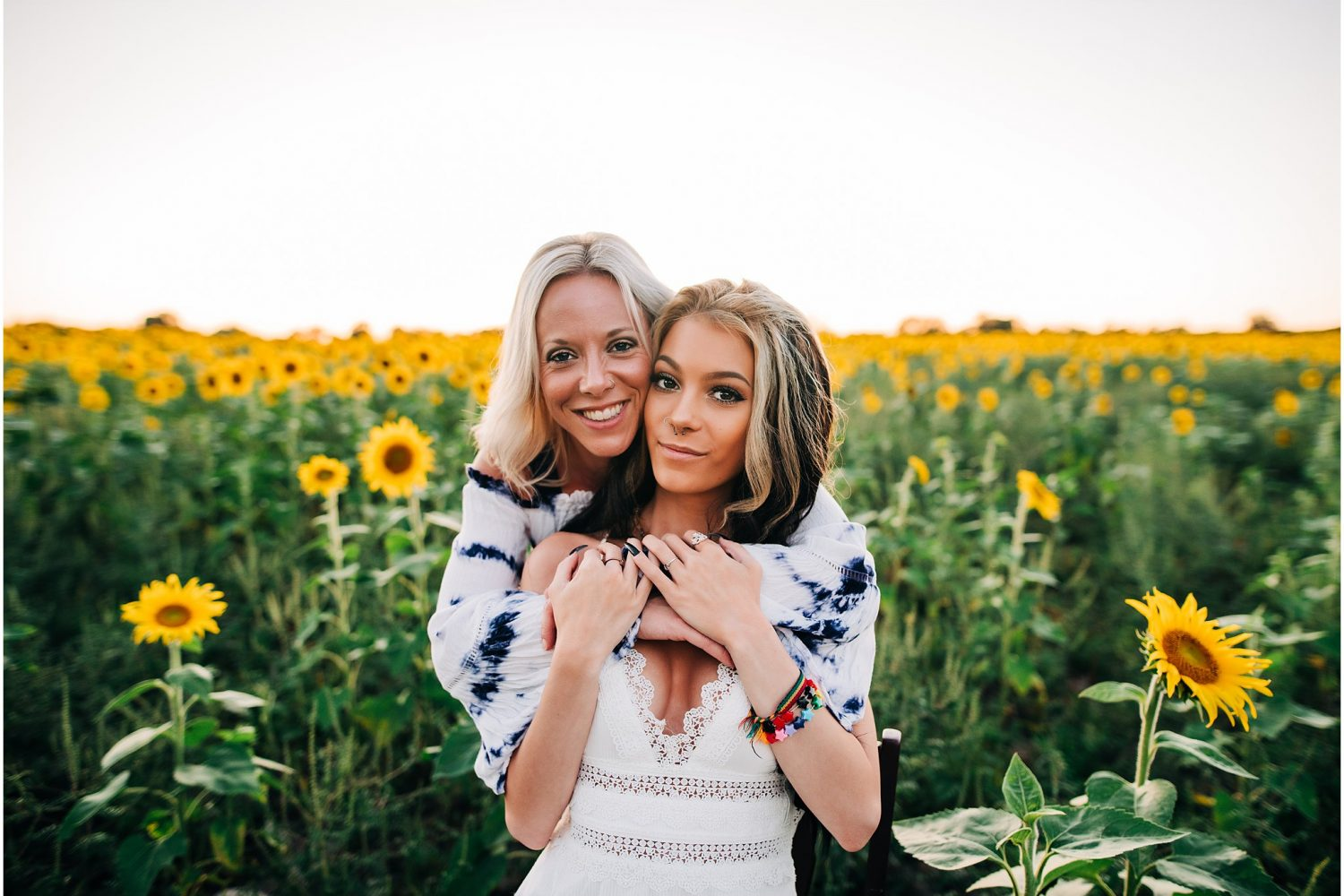 Mom and daughter surrounded by sunflower fields in Howell, MI at Munsell Farms